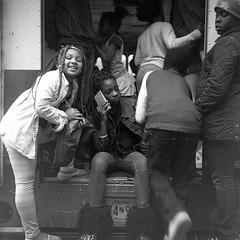 (patrickjoust) Tags: bookishbaltimore kidssafezone sandtown baltimore maryland superricohflex kodaktrix400 developedinrodinal150 tlr twin lens reflex 120 6x6 medium format black white bw home develop film blancetnoir blancoynegro schwarzundweiss manual focus analog mechanical patrick joust patrickjoust md usa us united states north america estados unidos autaut urban street city girls boys van phone