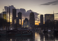 Rotterdam (Hans van der Boom) Tags: city sunset water netherlands silhouette clouds evening rotterdam cityscape center nl highrises harbours zuidholland