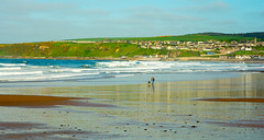 One Man And His Dog (williamrandle) Tags: sea dog seascape man green beach buildings landscape spring sand nikon holidays surf waves village outdoor bluesky hills shore northsea moray cullen 2016 banffshire northeastscotland d7100 tamron2470f28vc