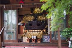 head of shishi (kasa51) Tags: sculpture smiling japan tokyo tsukiji grinning shirine  lionmask shishigashira