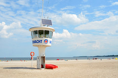 at the beach (Wolfgang Binder) Tags: sea summer sky holiday tower clouds landscape sand scenery lifeguard ostsee watchtower travemuende priwall beacht