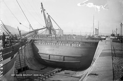 Alexandra Graving Dock, Belfast (1) (National Library of Ireland on The Commons) Tags: ireland horse docks workers ships belfast cranes crew northernireland funnels cart drydock ulster cavehill antrim glassnegative shipyards paddlesteamer gravingdock queensisland rothesaybay gaslighting robertfrench williamlawrence nationallibraryofireland alexandragravingdock lawrencecollection caissongate rubbingstrakes
