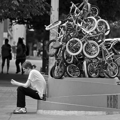 Toy Story (Ian Sane) Tags: street white man black smart oregon portland ian toy photography downtown phone cigarette candid cell bikes images bicycles story pile stark avenue 13th zoobomb burnside sane pyle zoobombers