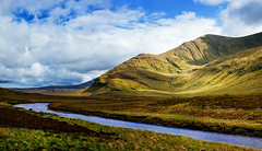 Another Scottish Landscape (Philipp Klinger Photography) Tags: uk greatbritain blue light sky panorama cloud sun sunlight mountain mountains green nature water grass clouds river landscape scotland nikon angle unitedkingdom britain heather pano united hill great wide