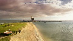 The iconic lighthouse of Marken surrounded by the indescribable changeable skies over the IJsselmeer