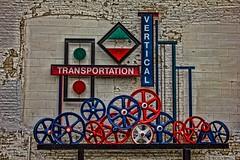 McNally Elevator Company, Kalamazoo (imagesFromKalamazoo) Tags: artwork mechanical steel spokes wheels elevator kalamazoo mcnally redwhiteandblue gears pulley westmichigan southernmichigan mcnallyelevatorcompany