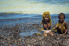 MDG-Ifaty-1201-225-v1 (anthonyasael) Tags: ocean africa blue girls sea shirtless portrait people playing black seaweed color beach nature water girl smile smiling horizontal kids naked children fun island happy kid sand funny colorful child barechested african turquoise indianocean portraiture half leisure algae transparent madagascar alga tulear ifaty toliara childrenonly anthonyasael