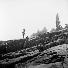 (patrickjoust) Tags: acadianationalpark mountdesertisland maine superricohflex kodakverichromepan100expired1981 developedinxtol11 vision:outdoor=0981 vision:car=059 tlr twin lens reflex 80 120 6x6 medium format black white bw home develop expired discontinued film blancetnoir blancoynegro schwarzundweiss manual focus analog mechanical patrick joust patrickjoust acadia national park mt mount desert island me usa us united states north america estados unidos autaut new england rocks amy llewelyn mother child standing shore trees