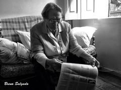 Pinacle of wisdom (Breno Salgado) Tags: old grandma bw woman newspaper women wisdom pinnacle
