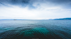 Greek Horizon (Nicola Pezzoli) Tags: travel blue sea summer sky nature water reflections landscape island boat cloudy wide greece skiathos