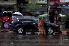 Rain in Chittagong (Ferdousi.) Tags: light umbrella rainyday streetphotography monsoon bangladesh chittagong
