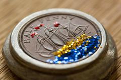 Shipwreck Treasure (DoctorTimbo) Tags: blue red macro glitter tin gold coin shiny treasure shipwreck 1965 cornish halfpenny macromonday canon100mmmacrol smallerthanacoin