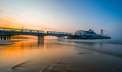 Bournemouth Pier at Sunrise (HarryWard11) Tags: morning light england sky orange seascape english beach yellow sunrise dark landscape coast pier sand long exposure waves coastal walkway sheen bournemouth beachscape