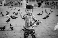 It's funny to feed pigeons (ericbeaume) Tags: street boy portrait people urban male monochrome birds asian kid nikon asia cambodge cambodia pigeons young nb phnompenh noirblanc 18105mm d5100 ericbeaume