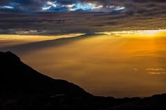 Tanzania - Mt Meru - Sunrise behind Kilimanjaro (mho.online) Tags: africa park sun colour kilimanjaro clouds sunrise canon point tanzania eos mt nebel hiking sigma peak national rhino afrika colourful farbe sonnenaufgang 18200 sonnenstrahl arusha sunbeams meru wanderung dunst tansania aufstieg gipfel 600d neblig kilimandscharo besteigung