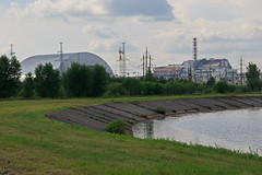 40 - Reactor 4 (Right) and the New Safe Confinement (Left) Chernobyl Nuclear Power Plant (Craig Hannah) Tags: uk plant building abandoned power explosion nuclear structure disaster sarcophagus huge disused shield left derelict powerstation chernobyl 2016 reactor4 hazardousarea zoneofalienation 30kilometrezone chernobyldisaster radioactivecontamination craighannah newsafetyconfinement