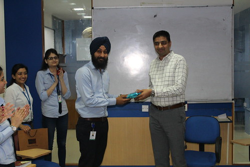 LinguaSoft EduTech's Senior Developer officer getting Employ of the month award from CEO Gurvinder Singh Kang