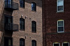 Brick Buildings (Geoffrey Coelho Photography) Tags: city windows light shadow urban building brick architecture buildings exterior balcony massachusetts architectural berkshires balconies streetscape lenox berkshirecounty