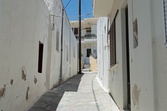 (Psinthos.Net) Tags: road houses light shadow summer sky sunlight june alley day bluesky neighborhood oldhouse cables noon oldhouses sunnyday paved    psinthos               overneighborhood