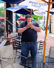 Light Up (Bruce Livingston) Tags: umbrella streetphotography cigar mothers smoker