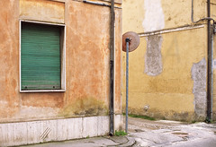 Street in Pisa, Tuscany (Shade-of-Light) Tags: street italy orange house colour green window yellow horizontal wall architecture corner photography mirror daylight italian alley closed cityscape pastel traditional nobody pisa persiana hues shade tuscany shutter weathered daytime local typical multicolored residential regional textured residentialarea tranquilscene trafficmirror vibrantcolor dimlight urbanscene traditionallyitalian mediterraneancountries mediterraneanculture penombra nongeneric avvolgibile lovelocal locationsandtravel domesticstructure