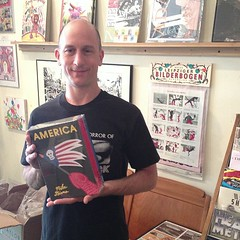 Mike Diana stopped by to restock his 1000-page collection of comix (Desert_Island) Tags: comics desertisland