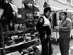 Das Auge des Gesetzes (einervonneruhr) Tags: street people bw white black pen silver spain market streetphotography olympus pro markt mallorca ep3 2013 1250mm efex mzuiko