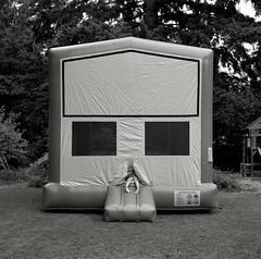 Inflatable House, Brentwood Street, Portland (austin granger) Tags: house film feet childhood tongue square eyes backyard play legs air helmet beak slide inflatable jaws bounce pincers bouncey gf670 austingranger