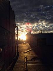 Post Office Parking Lot Sunset (sjrankin) Tags: california sunset sun northerncalifornia clouds mall evening parkinglot glare edited lensflare usps processed stripmall unitedstatespostoffice shinglesprings tonalcontrast shinglespringscalifornia 20september2013