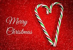 Merry Christmas! (Cindy's Here) Tags: christmas macro canon holidays candy merrychristmas challenge candycanes itsbeginningtolookalotlikechristmas ansh withcandycanesandsilverlanesthatglow