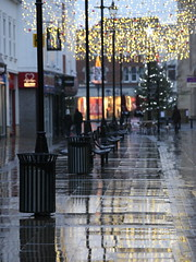 Wet New Years Day (717Images) Tags: christmas new reflection wet rain thames shopping bench puddle day 1st jan pavement seat year january newyear christmaslights abingdon 2014