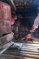 Preparing fish (HenryHutter) Tags: old fish cooking fashion tribal sarawak malaysia borneo local tribe annahrais bidhayu