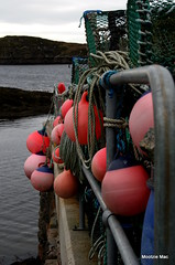 Buoys in Harris (mootzie) Tags: pink sea seaweed pier navy hanging harris ropes railing buoys creels buoyant amhuinnsuidhe roprs