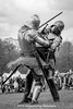 [2014-04-19@15.12.45a] (Untempered Photography) Tags: history monochrome costume fight helmet battle medieval weapon sword knight combat armour reenactment champions skirmish combatant chainmail canonef50mmf14 perioddress platearmour gambeson mailarmour untemperedeye canoneos5dmkiii untemperedeyephotography glastonburymedievalfayre2014