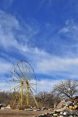 yellow wheel (slammerking) Tags: tree abandoned junk decay bluesky forgotten ferriswheel amusementpark scrap urbex defunct wichitaks joyland urbanex recreationaltrespassing