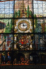 The clock and stained glass extract in Bilbao-Abando station (Sokleine) Tags: station spain gare interior stainedglass bilbao espana vitrail estacion espagne basquecountry paysbasque biscaia biscaye