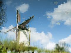 Representation of a reflected view (PvRFotografie) Tags: cloud reflection nature water windmill clouds rotterdam natuur wolken parc windmolen wolk reflectie zuiderpark rotterdamzuid rotterdamcharlois fujix20 fujifinepixx20