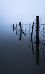 Still (lizcaldwell72) Tags: water reflection mist hawkesbay newzealand fencepost laketutira light