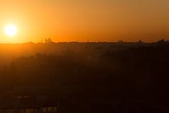 Golden Sunset (Elizabeth Stanton) Tags: city travel sunset summer vacation urban holiday tourism silhouette turkey landscape evening spring asia europe glow shadows view outdoor minaret exploring silhouettes istanbul calm adventure serenity destination goldensunset minarets