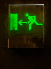 Fire Exiting (Steve Taylor (Photography)) Tags: uk greatbritain england brown white man black green london art sign digital fire scary unitedkingdom smoke running direction gb arrow exit frightening