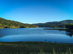 By the water (World-viewer) Tags: sunset mountain lake man mountains beach nature water birds landscape evening coast countryside fishing marine outdoor walk horizon shoreline scenic reservoir shore plus iphone iphone6