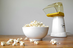 popcorn maker and popcorn in white bowl on table (yourbestdigs) Tags: food white hot yellow bag yummy healthy corn junk sweet eating salt tasty fair bowl pop sugar gourmet pot kettle salty butter snack popcorn movies carbohydrates treat buttered stir snacking canola kernel refreshment buttery salted kettlcorn