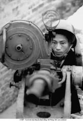 5575628 (ngao5) Tags: man outside gun vietnamese factory politics north vietnam viet revolution militia defense antiaircraft haiphong measures cong handling timeincnotown 5575628