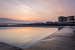 westward ho! tidal pool (jon.capps) Tags: ocean uk sea cloud holiday beach water sunrise rocks apartments tripod calm atlantic flats filter lowtide beachhuts tidalpool vaportrails shutterrelease manfrotto britan northdevon cokin westwardho ndgrad 60d nd03 hitechfilters 16xcrop canon1740mm14lusm