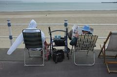 DSCF4794_small_F (Paul Russell99) Tags: beach newspaper seaside sand sitting empty weymouth paulrussell cagoule