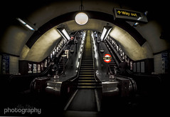 Say it twice (Explored) (Alex Chilli) Tags: light london up yellow stairs train underground fuji angle metro escalator tube wide steps x xa2 mount exit fujinon wayout jubileeline addon 1650 explored inexplore xmount