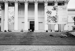 Museum Steps (gwpics) Tags: old people blackandwhite bw building heritage history film monochrome museum architecture advertising person mono blackwhite hungary budapest columns steps streetphotography lifestyle historic society socialdocumentary leicam7 doric hungarian socialcomment streetpics strasenfotograpfie