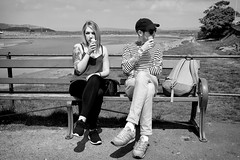 Tattoos And Cream (nigelhunter) Tags: street woman man ice tattoo bench coast pier seaside couple candid cream cap arnside