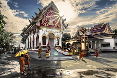 Peace after the Storm (HoustonHVAC170) Tags: street city travel sunset sky people sun building tourism architecture clouds umbrella asian outdoors temple four photography ancient asia buddhist religion culture monk buddhism laos wat savannakhet