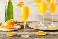 Homemade Refreshing Orange Mimosa Cocktails (brent.hofacker) Tags: party summer orange cold color ice glass yellow fruit bar bottle mixed mix wine drink sweet juice champagne rustic beverage hard lifestyle bubbles flute sparkle celebration cocktail liquor slice alcohol tropical bunch leisure citrus alcoholic mimosa refreshing liquid sparkling liqueur refreshment mimosas mimosacocktail